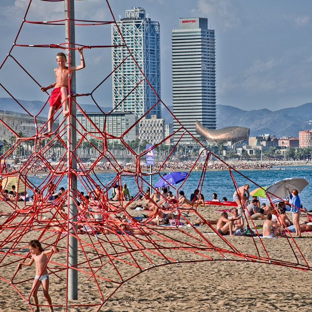 Children Playing on the Beach at Barceloneta, Barcelona, Spain