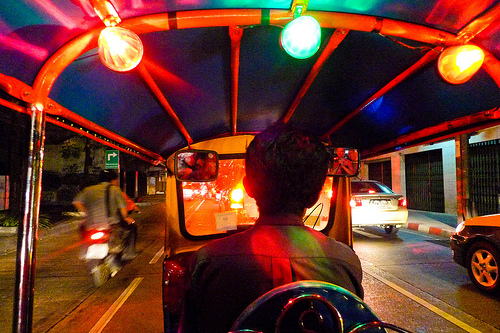 Photo of a A Tuk-Tuk Ride at Night Through Bangkok