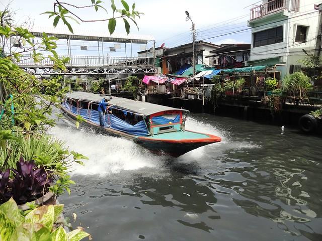 A Klong Taxi Cruising at Fast Speed Klong Saen Saep, Bangkok, Thailand