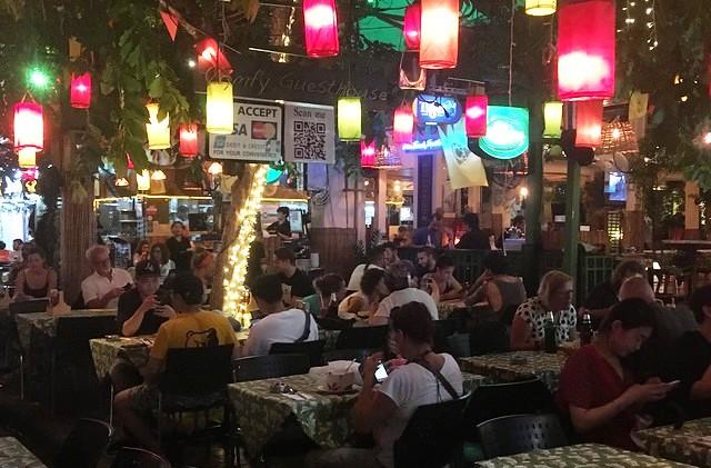 Dining at Soi Rambuttri, near Khao San Road, Banglamphu, Bangkok, Thailand