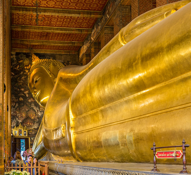 The Wat Pho Temple Complex houses the largest collection of Buddha images in Thailand, including a 46 m long reclining Buddha, Bangkok