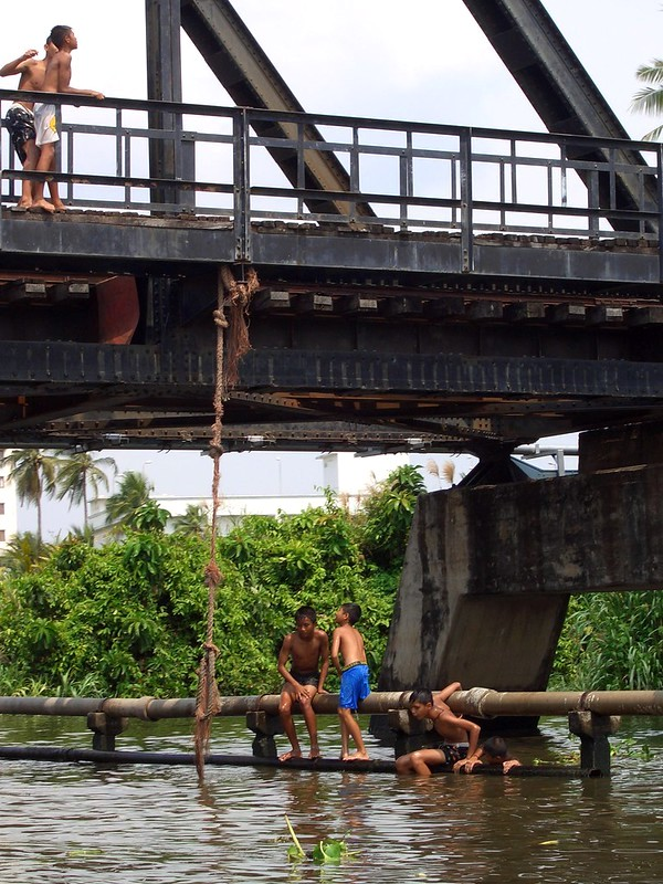 Kids Playing in a Canal of Thonburi, Bangkok, Thailand