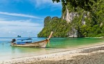Photo of a longtail at a beach in Krabi, Thailand
