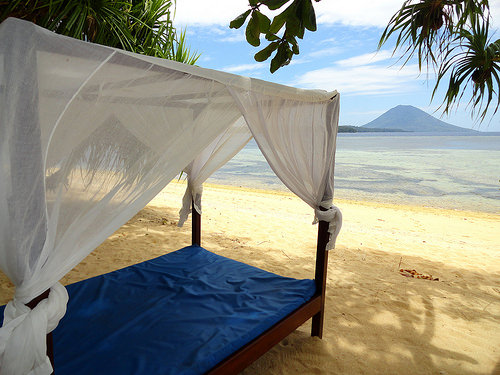 Day bed on the beach, Siladen Island Resort & Spa, Pulau Siladen, North Sulawesi, Indonesia