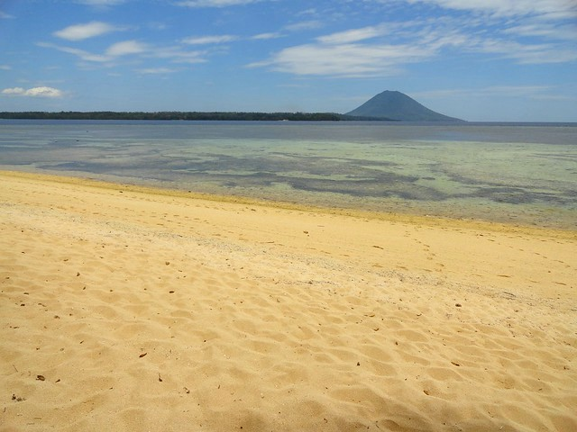 Flat Pulau Bunaken (on the left) and Manado Tua Volcano (center) from Pulau Siladen, North Sulawesi , Indonesia