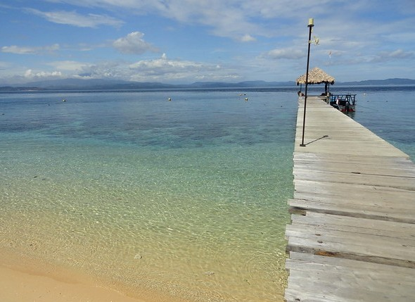 The Pier of Coral Eye in Pulau Bangka, North Sulawesi, Indonesia