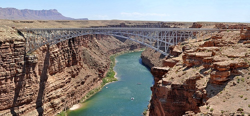 Boats on the Colorado River passing under Navajo Bridge in Marble Canyon, Grand Canyon NP, Arizona