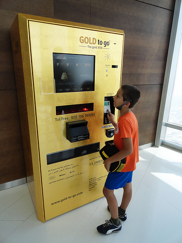 Gold bars dispensing ATM machine on top of Burj Khalifa, Dubai, United Arab Emirates