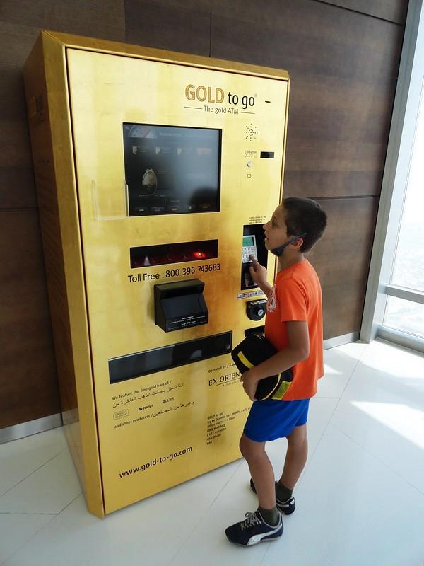 Gold bars dispensing ATM machine on top of Burj Khalifa, Dubai, United Arab Emirates