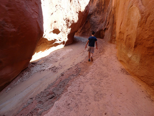My 12 year old son descending Dry Fork Narrows Dry Fork of Coyote Gulch Grand Staircase Escalante National Monument, Utah