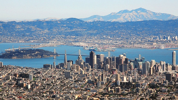 San Francisco, the Bay Bridge, Yerba Buena Island with Oakland and Berkeley and Mount Diablo in the distance, California