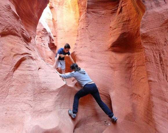 Scrambling in Peek-A-Boo Slot Canyon in the Dry Fork of Coyote Gulch in Grand Staircase-Escalante NM in Utah