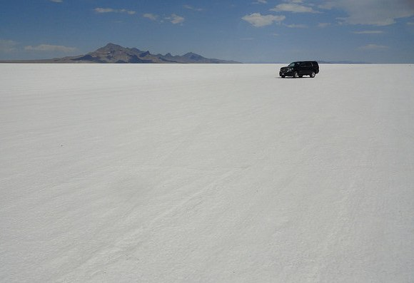 Driving my car in the heart of Bonneville Salt Flats, Utah