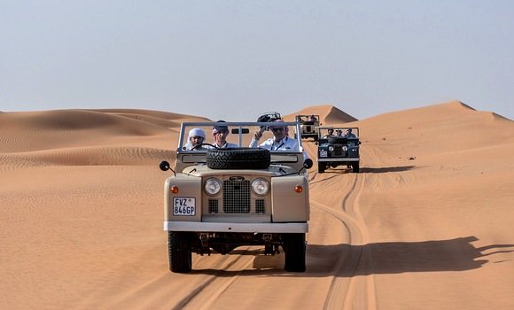 A Platinum Heritage Luxury Tours & Safaris Vintage 1950's Land Rover, Dubai Desert