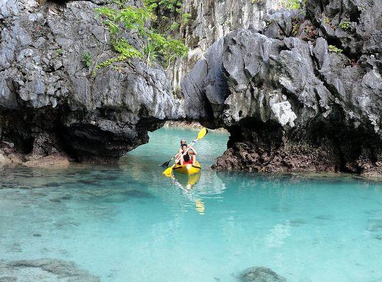 Kayak exiting Small Lagoon, Miniloc Island, Bacuit Bay, El Nido, Palawan, Philippines